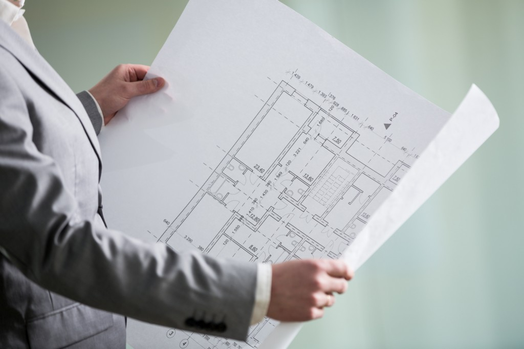 architectural plan in the architect's hands